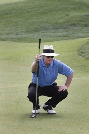 pga: Tom Kite of USA, check his 8th putting line during the PGA Tour Songdo IBD championship second round at Jack Nicklaus golf club in Incheon, west of Seoul, on Sep 17, 2011, South Korea. Editorial