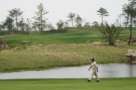 Tom Pernice Jr. of USA, moving after 18th hall approach during the PGA Tour Songdo IBD championship second round at Jack Nicklaus golf club in Incheon, west of Seoul, on Sep 17, 2011, South Korea. Editorial