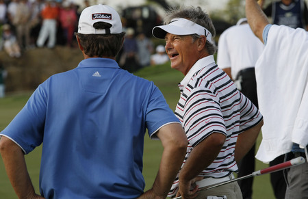 pga: John Cook of USA (R) and Jay Don Blake of USA, talking about their putting line of 18th hall during the PGA Tour Songdo IBD championship final round overtime at Jack Nicklaus golf club in Incheon on Sep 18, 2011.
