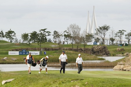 pga: Sandy Lyle of Scotland (C) and David Eger of USA (R), walk after 14th hall tee shot during the PGA Tour Songdo IBD championship final round at Jack Nicklaus golf club in Incheon on Sep 18, 2011.