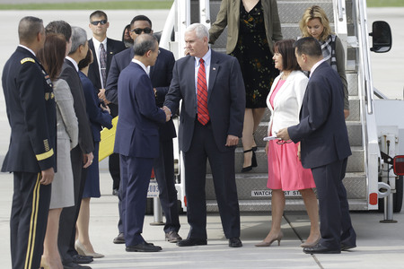 U.S. Vice President Mark Pence and Lim Sung Nam of South Korean First Vice Foreign minister shake hands after arrives at the Osan military Airport, South Korea. U.S. Vice President Mark Pence will travel to the Republic of Korea, Japan, Indonesia, Austral