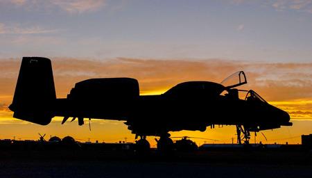 aerial bomb: A-10 Thunderbolt II sunset at Gunsan airbase, South Korea. Stock Photo