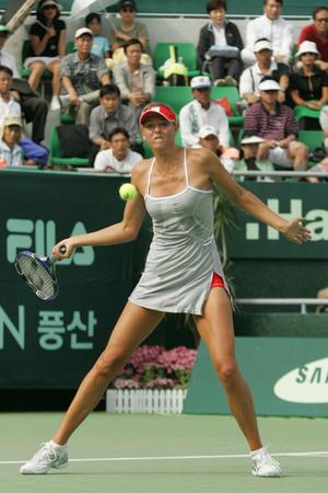 Russias Wimbledon champion Maria Sharapova returns a shot to Polands Marta Domachowska at the final of the Hansol Korea Open Tennis Championships in Seoul, October 3, 2004. Sharapova defeated Domachowska 6-1 6-1 and won the championship.