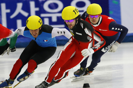 heats: Hamelin Charles, front, of Canada competes in the Men 500-meters heats of the ISU World Cup Short Track speed Skating Championship 2009 2010 on September 24, 2009, South Korea. Editorial