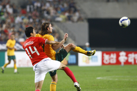 joshua: Joshua Kennedy of Australia and Lee Jung-Soo of South Korea compete for the ball during the international friendly match between South Korea and the Australian Socceroos at Seoul World Cup Stadium on September 5, 2009 in Seoul, South Korea.