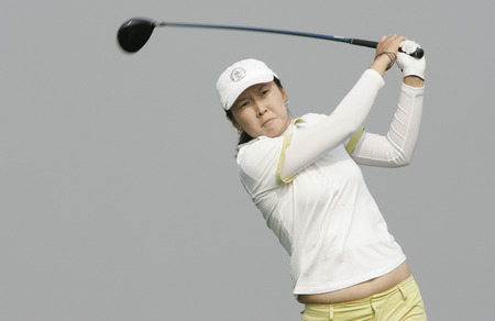 Candie Kung of Taiwan hits a teeshot in the 6th hole during round one of Hana Bank Kolon Championship at Sky 72 Golf Club on October 30, 2009 in Incheon, South Korea.