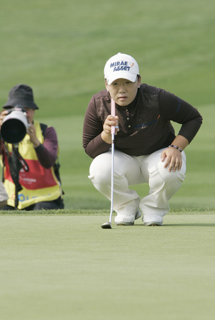 Jiyai Shin of South Korea in the 9th hole during the round of Hana Bank Kolon Championship at Sky 72 Golf Club on October 30, 2009 in Incheon, South Korea.