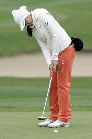 M. J. Hur of South Korea putts on the 2th hole during final round of Hana Bank Kolon Championship at Sky 72 Golf Club on November 1, 2009 in Incheon, South Korea.