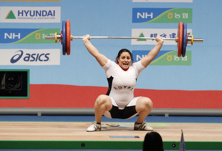 Ibrahim Mohamed Afaf of Egypt competes in the womens + 75kg weightlifting snatch at the World Weightlifting Championships in Goyang, north of Seoul, November 28, 2009.