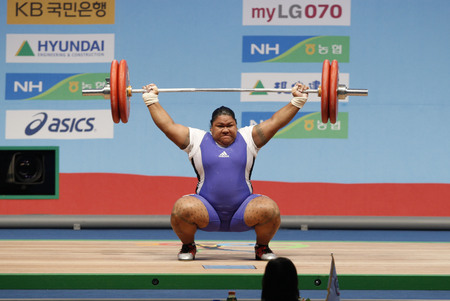 dimly: Opeloge Elements of Samoa Competition in the womens + 75kg weightlifting snatch at the World Weightlifting Championships in Goyang, north of Seoul, November 28, 2009.