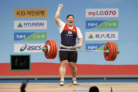 South Koreas Jang Mi-ran celebrates after the womens +75kg weightlifting clean and jerk category at the World Weightlifting Championships in Goyang, north of Seoul, November 28, 2009. Jang set a new world record with a record of 187 kg in the clean and
