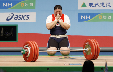 South Koreas Jang Mi-ran competes in the womens +75kg weightlifting clean and jerk category at the World Weightlifting Championships in Goyang, north of Seoul, November 28, 2009. Jang set a new world record with a record of 187 kg in the clean and jerk