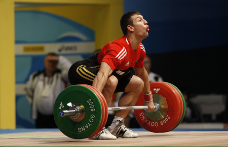 Schwarzbach Tom of Germany competes in the Mens 85kg Group B weightlifting snatch competition at the World Weightlifting Championship in Goyang, north of Seoul on Thursdays, November 26, 2009, South Korea. Editorial