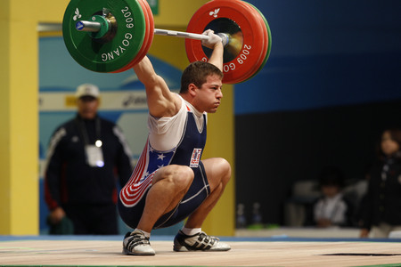 Bruce Matthew of United States competes in the Mens 85kg Group B weightlifting snatch at the World Weightlifting Championship in Goyang, north of Seoul on Thursdays, November 26, 2009, South Korea.