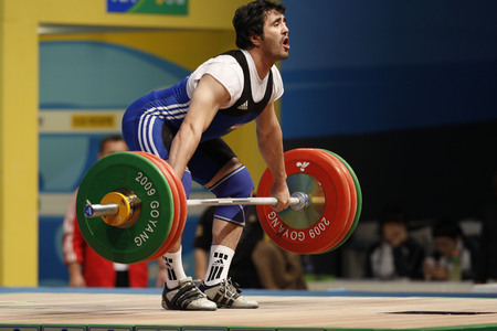 Yusupov Sherzodjon of Uzbekistan competes in the Men's 85kg Group B weightlifting snatch competition at the World Weightlifting Championship in Goyang, north of Seoul on Thursdays, November 26, 2009, South Korea.