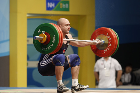 Tkac Richard of Slovakia competes in the Mens 85kg Group B weightlifting snatch at the World Weightlifting Championship in Goyang, north of Seoul on Thursdays, November 26, 2009, South Korea. Editorial