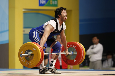 Yusupov Sherzodjon of Uzbekistancompetes in the Mens 85kg Group B weightlifting snatch competition at the World Weightlifting Championship in Goyang, north of Seoul on Thursdays, November 26, 2009, South Korea.