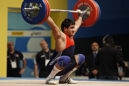 dimly: Zairov Intiqam of Azerbaijan competes in the Mens 85kg Group A weightlifting snatch competition at the World Weightlifting Championship in Goyang, north of Seoul on Thursdays, November 26, 2009, South Korea.