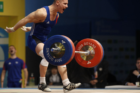Hennequin Benjamin of France competes in the Mens 85kg Group A weightlifting snatch at the World Weightlifting Championship in Goyang, north of Seoul on Thursdays, November 26, 2009, South Korea.