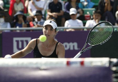 Maria Jose Martinez Sanches of Spain returns to Galena Voskoboeva of Kazakhstan on Day 7 in the Hansol Korea Open Tennis final round at the Olympic Park tennis cout in eastern Seoul on Sep 25, 2011, South Korea. Martinez Sanchez beat Kazakhstans Galina V