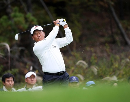October 21, 2011 - Yeoju, South Korea : KJ Choi of South Korea, play approach shot on the 4th fairway during an 2011 CJ Invitational Golf  second round at Haesley Nine Bridge Golf Club.