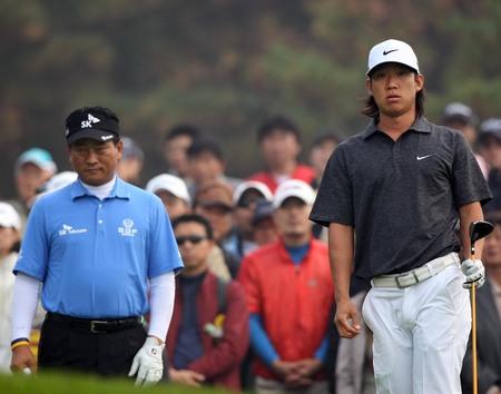 October 23, 2011 - Yeoju, South Korea : KJ Choi of South Korea, and Anthony Kim of USA, plays on the fairway during an 2011 CJ Invitational Golf  final round at Haesley Nine Bridge Golf Club.