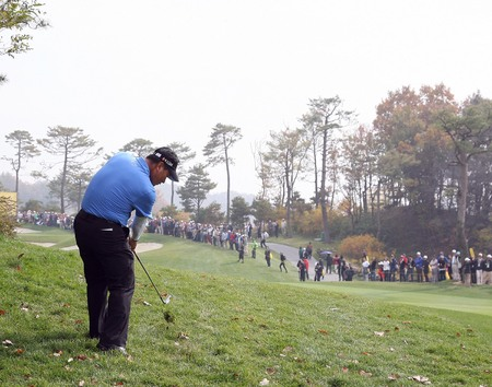 October 23, 2011 - Yeoju, South Korea : KJ Choi of South Korea, play approach shot on the fairway during an 2011 CJ Invitational Golf  final round at Haesley Nine Bridge Golf Club. Editorial