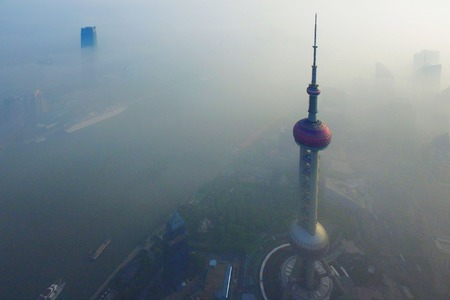 Median processing image of shows fog-shrouded buildings in Shanghai.