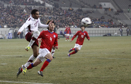 March 14, 2012 - South Korea, Seoul : Jang Hyun-soo of South Korea and Naser Nabeel K Saad of Qatar players compete ball during their Asia qualifying for the 2012 London Olympic in Sangam stadium. The match ended in 0-0.