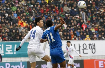 compete: February 25, 2012 - South Korea, Jeonju City : Bokhodir Nasimov of Uzbekistan and Lee Jung-soo of South Korea compete ball at the South Korea and Uzbekistan football friendly match in Jeonju World Cup stadium.