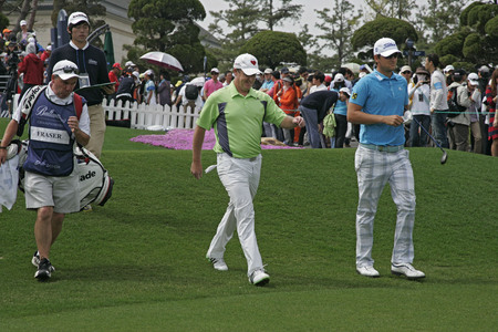 April 29, 2012-South Korea, Icheon : Bernd Wiesberger of Austria and Mrcus Fraser of Australia in green during the fourth round of the Ballantines Championship at Blackstone Golf Club.