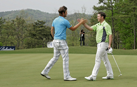 April 29, 2012-South Korea, Icheon : Bernd Wiesberger of Austria(L) winning ceremony during fourth round of the Ballantines Championship at Blackstone Golf Club.