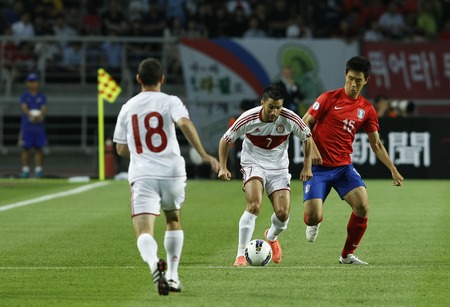 June 12, 2012 - Goyang, South Korea : Lebanon of Hassan Maatouk and South Korea of Oh Beom Seok compete ball during the FIFA World Cup Asian Qualifier match between South Korea and Lebanon at the Goyang sports complex. Editorial