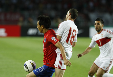 June 12, 2012 - Goyang, South Korea : Lebanon of Walid Ismail  and South Korea of Oh Beom Seok compete ball during the FIFA World Cup Asian Qualifier match between South Korea and Lebanon at the Goyang sports complex.