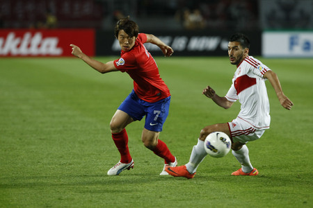 June 12, 2012 - Goyang, South Korea : Lebanon of Hassan Maatouk and South Korea of Kim Bo Kyung compete ball during the FIFA World Cup Asian Qualifier match between South Korea and Lebanon at the Goyang sports complex.