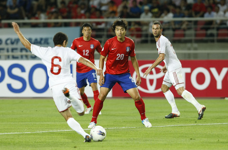 June 12, 2012 - Goyang, South Korea : Labanon of Mohamad Chaiyhans and South Korea of Lee Dong Gook compete ball during the FIFA World Cup Asian Qualifier match between South Korea and Lebanon at the Goyang sports complex.