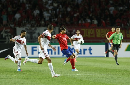 June 12, 2012 - Goyang, South Korea : Labanon of  Youssef Mohamad and South Korea of Lee Dong Gook compete ball during the FIFA World Cup Asian Qualifier match between South Korea and Lebanon at the Goyang sports complex. Editorial