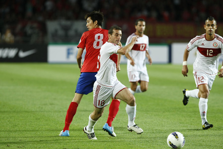 June 12, 2012 - Goyang, South Korea : Labanon of  Walid Ismail and South Korea of Kim Jung Woo compete ball during the FIFA World Cup Asian Qualifier match between South Korea and Lebanon at the Goyang sports complex. Editorial