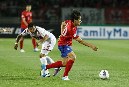 June 12, 2012 - Goyang, South Korea : Labanon of  Nade Matar and South Korea of Lee Dong Gook  compete ball during the FIFA World Cup Asian Qualifier match between South Korea and Lebanon at the Goyang sports complex.