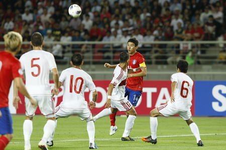 June 12, 2012 - Goyang, South Korea : Labanon of  Bilal Cheikh El Najjarine and South Korea of Lee Jung Soo compete ball during the FIFA World Cup Asian Qualifier match between South Korea and Lebanon at the Goyang sports complex.