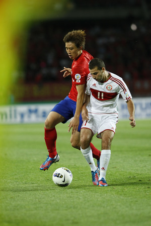 June 12, 2012 - Goyang, South Korea : Labanon of  Ahmad Zreik  and South Korea of Koo Ja Cheol  compete ball during the FIFA World Cup Asian Qualifier match between South Korea and Lebanon at the Goyang sports complex.