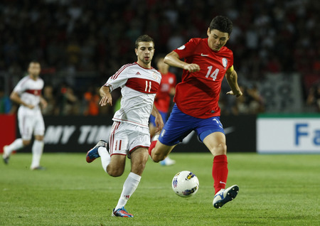 June 12, 2012 - Goyang, South Korea : Labanon of  Ahmad Zreik  and South Korea of Lee Jung Soo   compete ball during the FIFA World Cup Asian Qualifier match between South Korea and Lebanon at the Goyang sports complex.