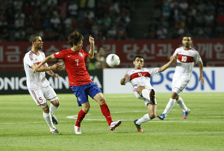June 12, 2012 - Goyang, South Korea : Labanon of  Mohamad Chaiyhas and South Korea of Kim Bo Kyung compete ball during the FIFA World Cup Asian Qualifier match between South Korea and Lebanon at the Goyang sports complex.