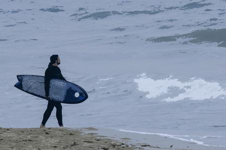 Oil paint of surfer find big wave in busan, Korea.