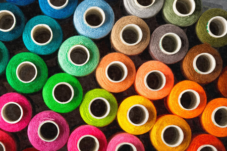 Oil paint of colorful wool skein displayed on the showcase. Stock Photo