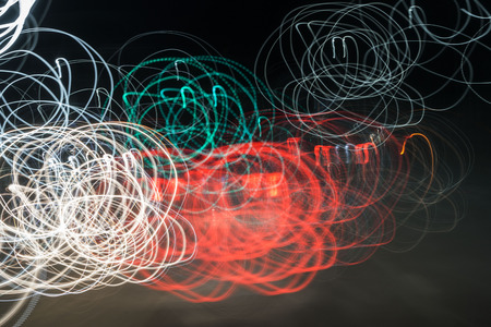 A colorful lighting show on the urban road