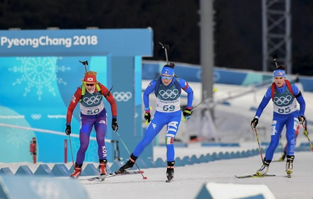 Feb 15, 2018-Pyeongchang, South Korea-FROLINA Anna of South Korea, WIERER Dorothea of Italy, FIRESTEEL REID Joanne of USA actionon the slope during an Olympic Biathlon Indivisual Women 15Km at Alpensia Biathlon Center in Pyeongchang, South Korea. Editorial