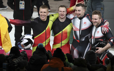 Feb 19, 2018-Pyeongchang, South Korea-Francesco FRIEDRICH, Thorsten MARGIS of Germany and Justin KRIPPS, Alexander KOPACZ of Canada Win ceremony after competition during an Olympic Bobsleigh 2Man Run Heat at Olympic Sliding Center in Pyeongchang, South Ko Editorial