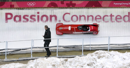 Feb 15, 2018-Pyeongchang, South Korea-Austria Team action on the ice during an Olympic Bobsleigh 2 Man Official Training at Olympic Sliding Center in Pyeongchang, South Korea.
