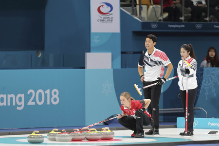 Feb 11, 2018-Gangneung, South Korea-Lee Ki Jeong, Jang Hye Ji of South Korea and Kaitlyn Lawes of Canada in action during the 2018 Pyeongchang Winter Olympic Curling Mix Double Session 7th D Korea v Curling Center in Gangneung, South Korea.